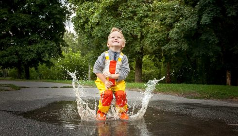 Kid Jumping in a Puddle